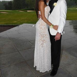 Scala cream and white prom dress.